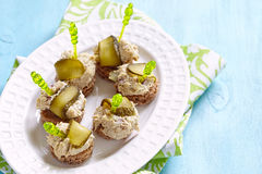 Canapes with fish pate and pickle Stock Photos