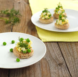 Canapes with green peas salad Stock Image