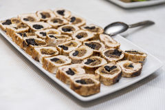 Canapes with ham, barbecue, plums and bread sticks Stock Image