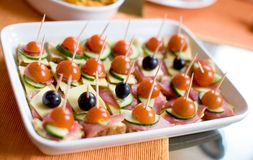 Canapes with ham, cheese, tomatos and olives Stock Photo