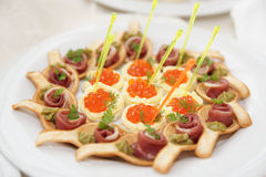 Canapes with ham and salmon caviar tartlets Stock Photos