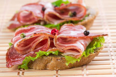 Canapes with ham Royalty Free Stock Photos