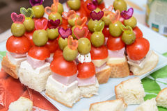 Canapes with ham tomato and olive on a toothpick Stock Photo