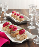 Canapes with herring fillets and beets Stock Photo