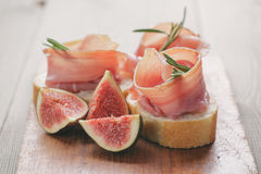 Canapes with jamon and figs on table Royalty Free Stock Photography