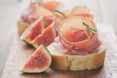 Canapes with jamon and figs on table Royalty Free Stock Image