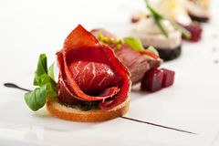 Canapes. Jamon Canapes with Pesto Sauce Royalty Free Stock Images