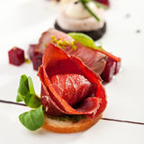 Canapes. Jamon Canapes with Pesto Sauce Stock Photo