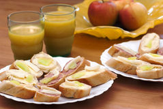 Canapes with juice and apples Stock Image