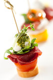 Canapes. Meat and Vegetables Canapes over White Royalty Free Stock Photography