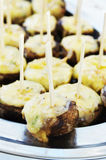 Canapes with melted cheese Stock Images