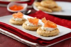 Canapes with oat bran cookies, smoked salmon and cream cheese Stock Images