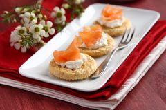 Canapes with oat bran cookies, smoked salmon and cream cheese Royalty Free Stock Image