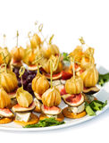 Canapes with physalis, fig, cheese crackers Stock Photography