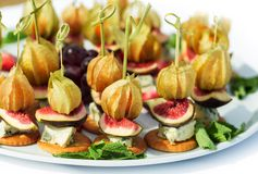 Canapes with physalis, fig, cheese, crackers Stock Photo