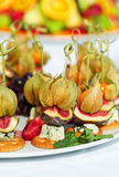 Canapes with physalis, fig, cheese with crackers Stock Photos