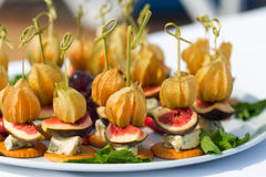 Canapes with physalis, fig, cheese and crackers Stock Images