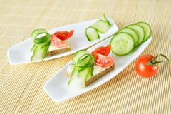 Canapes on plate Stock Photography