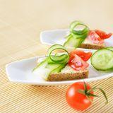 Canapes on plate Stock Photos