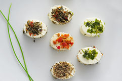 Canapes. A plate with some different canapes, with cheese cream and different spices, served as appetizer Royalty Free Stock Images