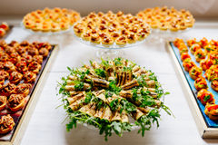 Canapes on plates Stock Images