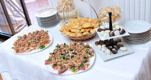 Canapes, pralines , bakery on a table Royalty Free Stock Photography