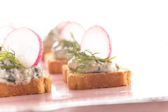 Canapes  with radish Royalty Free Stock Photo