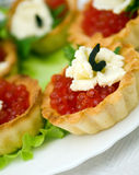 Canapes with red caviar Stock Image