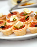 Canapes with red caviar   . Stock Photo