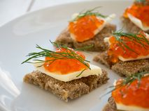 Canapes with red caviar and butter Stock Images
