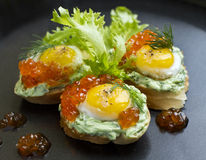 Canapes with red caviar with quail eggs Stock Image