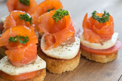 Canapes with red fish Royalty Free Stock Image