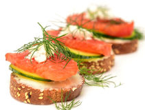 Canapes. With red fish on white Stock Photos