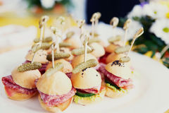 Canapes on restaurant table, daylight Royalty Free Stock Photos