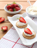 Canapes with ricotta cheese and strawberry. On the plate Royalty Free Stock Images