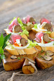 Canapes with roast beef and truffles stock images