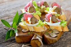 Canapes with roast beef and truffles royalty free stock images