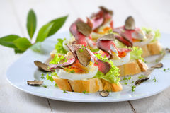 Canapes with roast beef and truffles royalty free stock photos