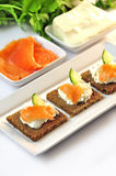 Canapes rye bread with ricotta cheese and smoked salmon Royalty Free Stock Photography