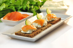 Canapes rye bread with ricotta cheese and smoked salmon Stock Images