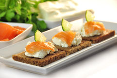Canapes rye bread with ricotta cheese and smoked salmon Royalty Free Stock Images