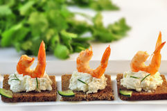 Canapes rye bread with ricotta cheese and tails of shrimps Royalty Free Stock Image