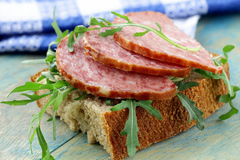 Canapes with salami. And arugula stock images