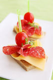 Canapes with salami Stock Image