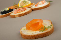 Canapes of salmon Stock Image