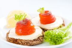 Canapes with salmon. Royalty Free Stock Image