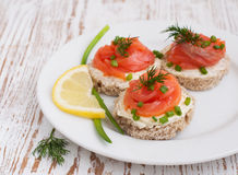 Canapes with  salmon Stock Photos