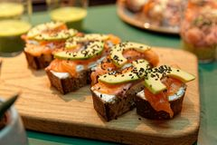 Canapes with salmon and avocado slices royalty free stock photography