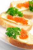 Canapes with salmon caviar Stock Photos
