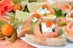 Canapes with salmon and caviar Royalty Free Stock Image